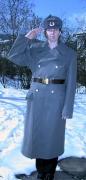Russischer Mantel mit Fellmütze